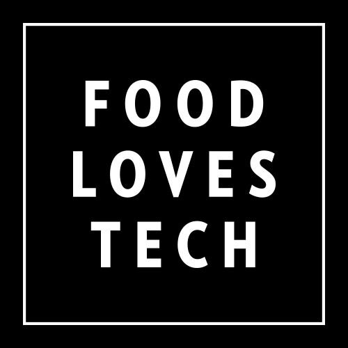 Food Loves Tech logo with white lettering on a black background